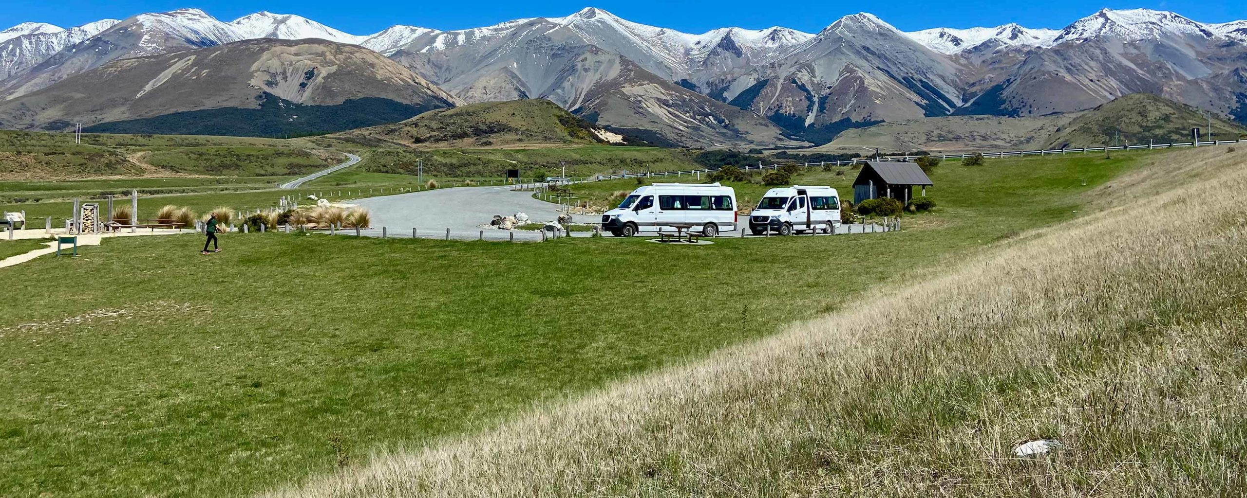 Campervans with high country background